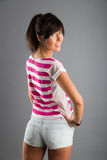 Beautiful athletic girl on a gray background Royalty Free Stock Images