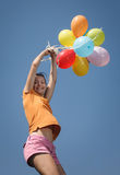Beautiful and athletic Girl jumping with balloons Stock Photography