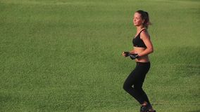 Beautiful athletic girl running on the left side stock video footage