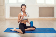 Beautiful athletic sporty woman sitting on yoga Royalty Free Stock Image