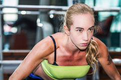 Beautiful athletic sporty young girl working out Stock Images