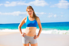 Beautiful Athletic Woman at the Beach Stock Image
