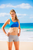 Beautiful Athletic Woman at the Beach Royalty Free Stock Photo
