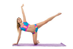 Beautiful athletic woman doing pilates exercise Stock Photography