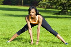 Beautiful athletic woman doing stretching exercise Royalty Free Stock Images