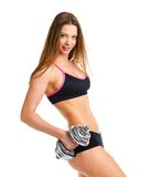 Beautiful athletic woman with dumbbells doing sport exercise, is Royalty Free Stock Image