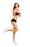 Beautiful athletic woman with dumbbells doing sport exercise, is Royalty Free Stock Images