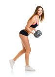 Beautiful athletic woman with dumbbells doing sport exercise, is Royalty Free Stock Photography