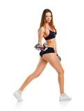 Beautiful athletic woman with dumbbells doing sport exercise, is Stock Photography
