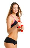 Beautiful athletic woman with dumbbells doing sport exercise, is Stock Image