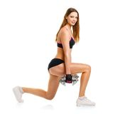 Beautiful athletic woman with dumbbells doing sport exercise, is Stock Photo