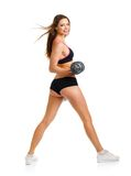 Beautiful athletic woman with dumbbells doing sport exercise, is Stock Images