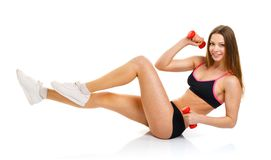 Beautiful athletic woman with dumbbells doing sport exercise, is Stock Photos