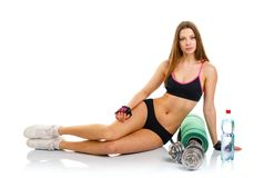 Beautiful athletic woman with dumbbells, mat for fitness, a bott Royalty Free Stock Photos