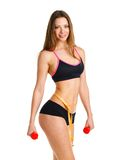 Beautiful athletic woman with dumbbells and with measuring tape Stock Image