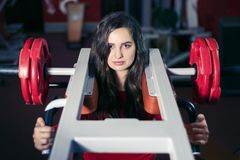 Beautiful athletic woman is engaged in the gym on the simulator stock photos