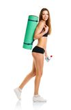 Beautiful athletic woman with mat for fitness and bottle of wate Stock Photography