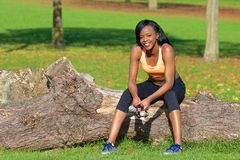 Beautiful athletic woman resting after exercise in the park Royalty Free Stock Photo