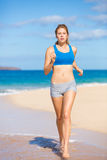 Beautiful Athletic Woman Running on the Beach Stock Photography