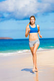 Beautiful Athletic Woman Running on the Beach Royalty Free Stock Image