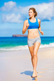 Beautiful Athletic Woman Running on the Beach Stock Photos