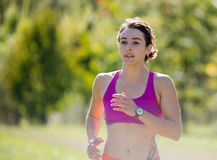 Beautiful athletic woman running in countryside Royalty Free Stock Photography