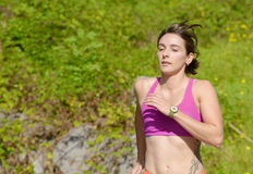 Beautiful athletic woman running in countryside Royalty Free Stock Image