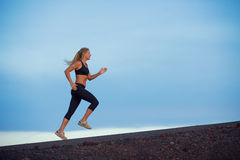 Beautiful athletic woman running jogging outside Royalty Free Stock Photo