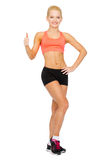 Beautiful athletic woman showing thumbs up Royalty Free Stock Photos