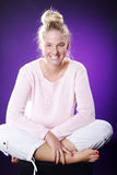 Beautiful athletic woman sitting on floor Royalty Free Stock Photo