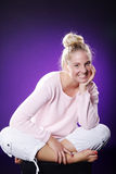 Beautiful athletic woman sitting on floor Royalty Free Stock Image