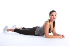 Beautiful athletic woman in sports outfit on floor Stock Images