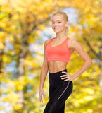 Beautiful athletic woman in sportswear Stock Images