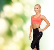 Beautiful athletic woman in sportswear Stock Photos