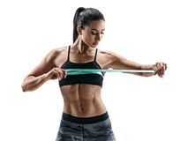 Beautiful athletic woman with tape measures the size of the breast. Royalty Free Stock Images