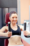 Beautiful athletic woman using a bench press Stock Photography
