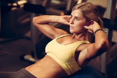 Beautiful athletic woman working ab intervals in fitness. Beautiful athletic woman working ab intervals Royalty Free Stock Photo