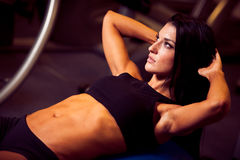 Beautiful athletic woman working ab intervals in fitness Stock Photo