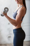 Beautiful athletic woman workout with dumbell Royalty Free Stock Photo