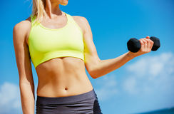 Beautiful athletic young woman exercising Royalty Free Stock Photo