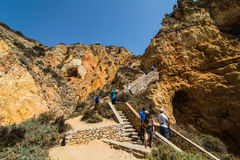 Beautiful atlantic ocean view horizon with sandy beach rocks with stairs on beach on Atlantic ocean in Portugal. Summer vocation stock image