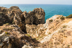 Beautiful atlantic ocean view horizon with sandy beach rocks and waves at sunrise algarve. Summer vocation Stock Photography