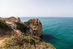 Beautiful atlantic ocean view horizon with sandy beach rocks and waves at sunrise algarve. Summer vocation Royalty Free Stock Images