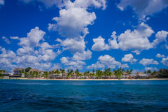 Beautiful attraction of Cozumel with some natural buildings and yachts, gorgeous blue ocean and sky Stock Photography