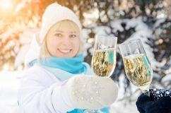 Beautiful attractive blonde clinks a glass of champagne in her hands celebrates the New Year stock image