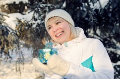 Beautiful attractive blonde girl rejoices in a box with a gift royalty free stock photo
