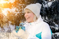 Beautiful attractive blonde girl rejoices in a box with a gift t stock image