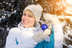 Beautiful attractive blonde girl in sportswear holding a ball to royalty free stock photos
