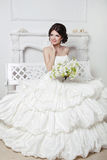 Beautiful attractive bride in wedding luxurious dress with volum Royalty Free Stock Photography