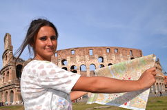 Beautiful attractive brunette tourist girl close to majestic Colosseum in Rome, Italy Stock Images